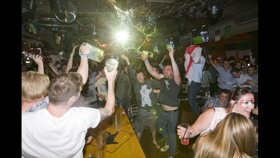 England supporters celebrate in the Walkabout bar in central London after Daniel Sturridge's 37th-minute goal.