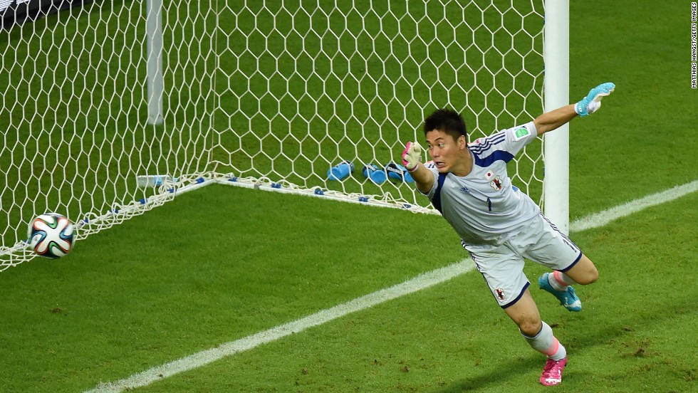 Japanese goalkeeper Eiji Kawashima tries in vain to stop a Wilfried Bony header from going in for Ivory Coast's first goal.