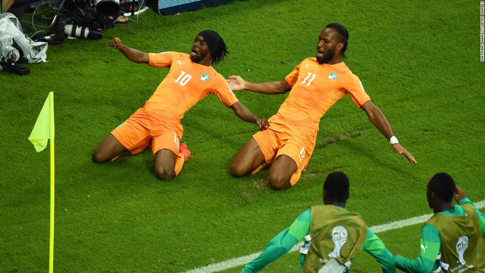 "Gervinho of the Ivory Coast, left, celebrates scoring his team's second goal with teammate Didier Drogba during the World Cup match between the Ivory Coast and Japan at Arena Pernambuco on June 14 in Recife, Brazil. Ivory Coast defeated Japan 2-1. It was the third day of the tournament, which is being held in 12 cities across Brazil. <a href=""http://www.cnn.com/2014/06/13/football/gallery/world-cup-0613/index.html"" target=""_blank"">See Saturday's best photos</a>"