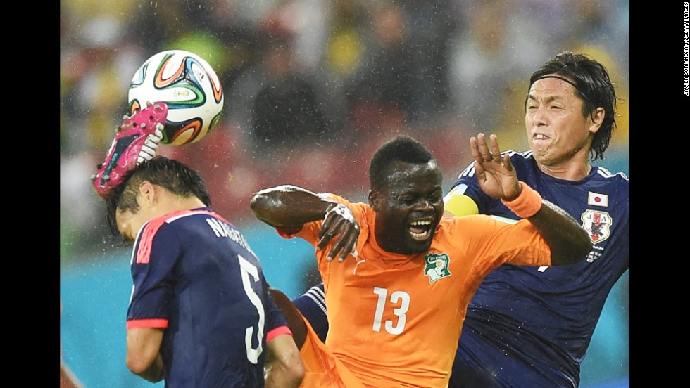 Ivory Coast midfielder Didier Ya Konan vies for the ball with a couple of Japanese players during their World Cup match Saturday, June 14, in Recife, Brazil. Ivory Coast won the match 2-1.