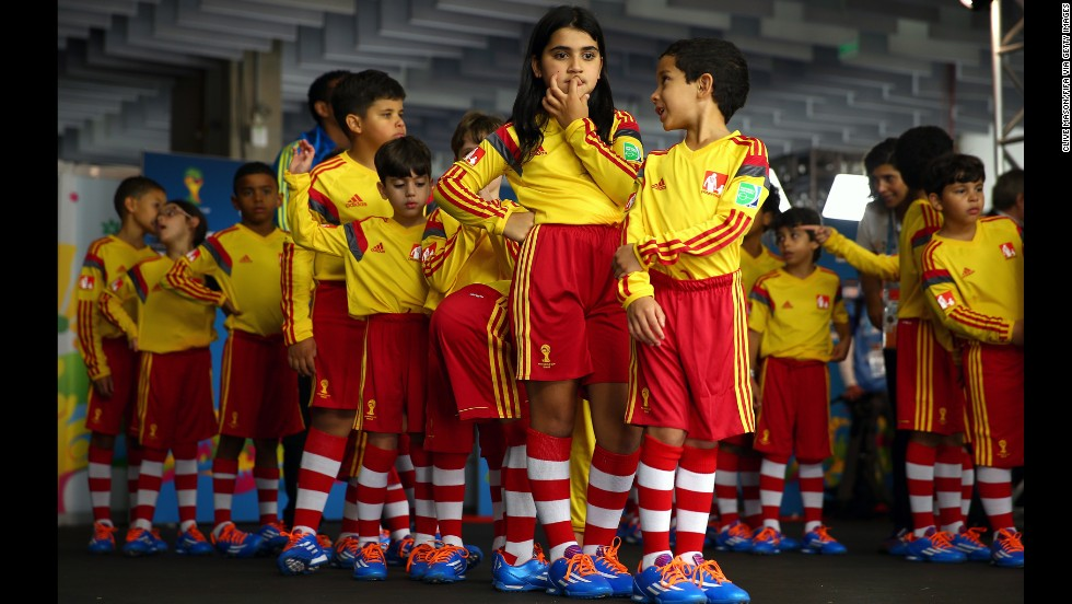 Young team mascots prepare to enter the pitch with the players prior to the match.