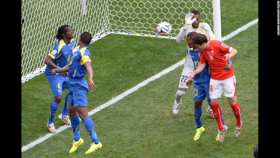 Switzerland's halftime replacement, Admir Mehmedi, scores the equalizer against Ecuador.