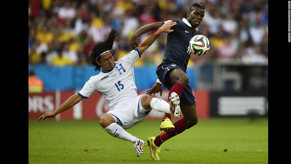 Honduras midfielder Roger Espinoza, left,  vies with France's Paul Pogba.