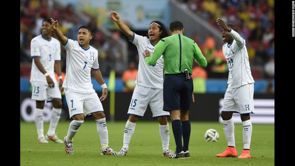 Members of the Honduras team gesture to Brazilian referee Sandro Meira Ricci.