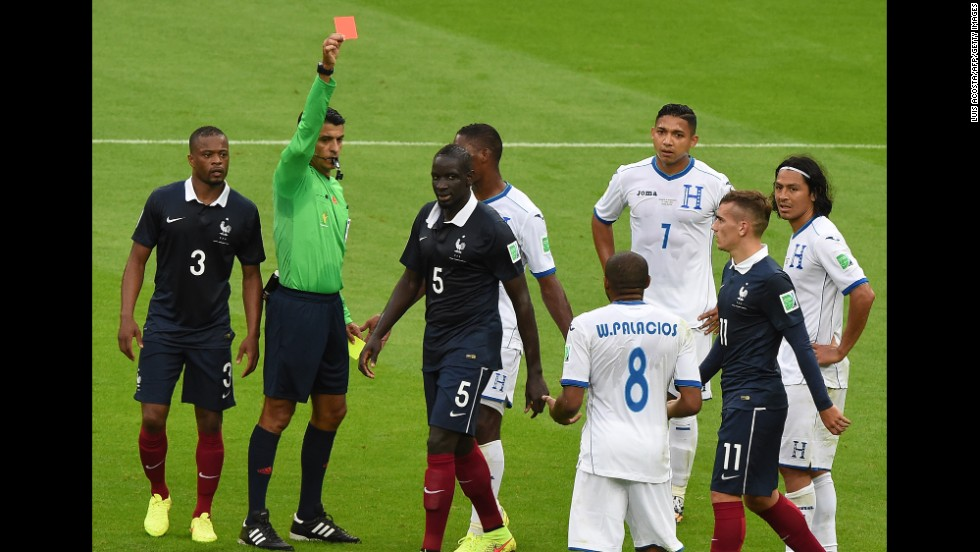 Honduras midfielder Wilson Palacios, center, receives a red card from Brazilian referee Sandro Meira Ricci.