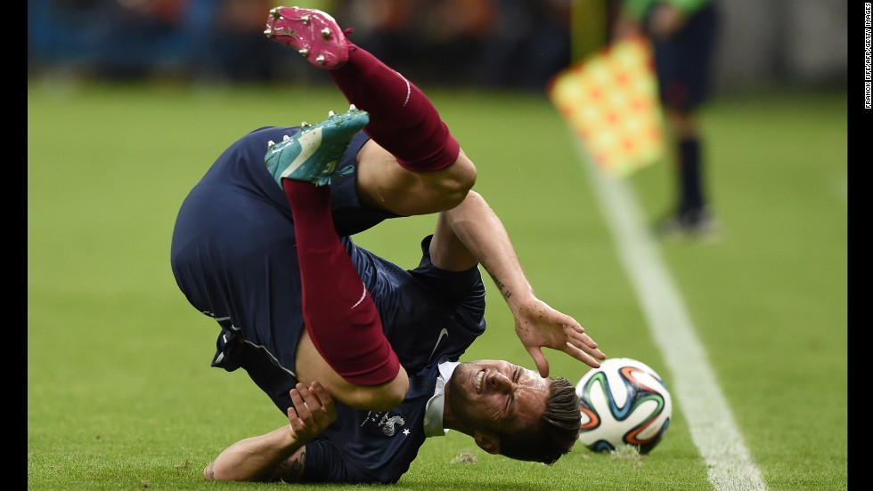 France forward Olivier Giroud takes a tumble.