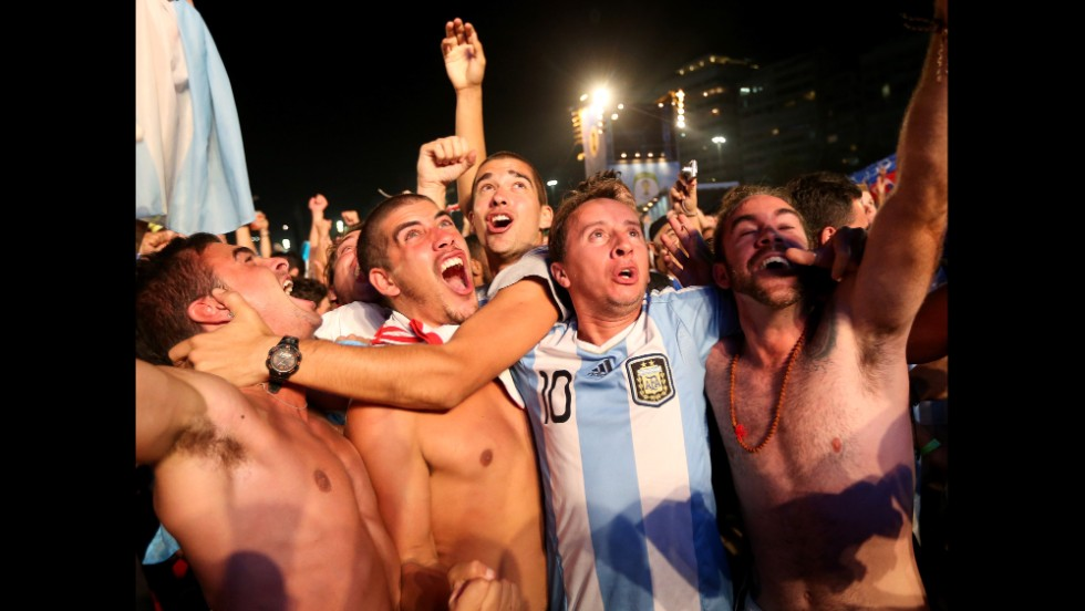 Argentine fans react to their team's first goal as they watch on a giant screen on Copacabana beach in Rio de Janeiro, Brazil.
