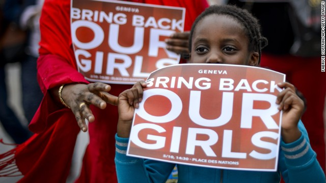 A young participant shows a placard during a demonstration in Geneva on May 10, 2014 in support of the abducted Nigerian school girls and their families.