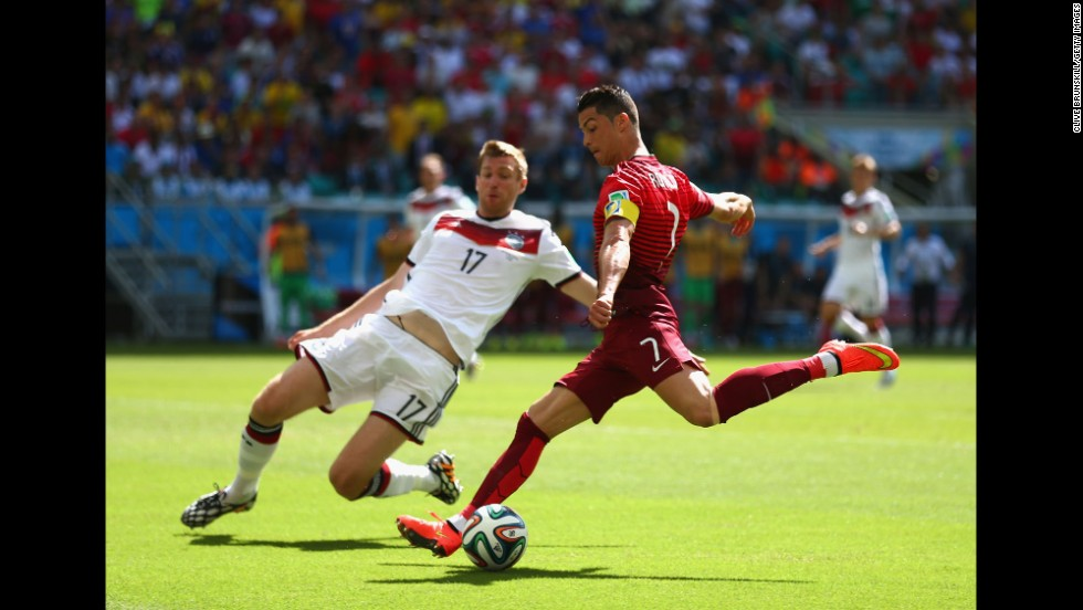 Ronaldo shoots near Per Mertesacker of Germany.