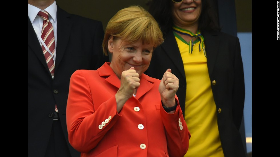 German Chancellor Angela Merkel watches the game in person.
