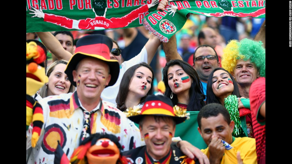 Germany and Portugal fans are seen together in the stadium before the game.