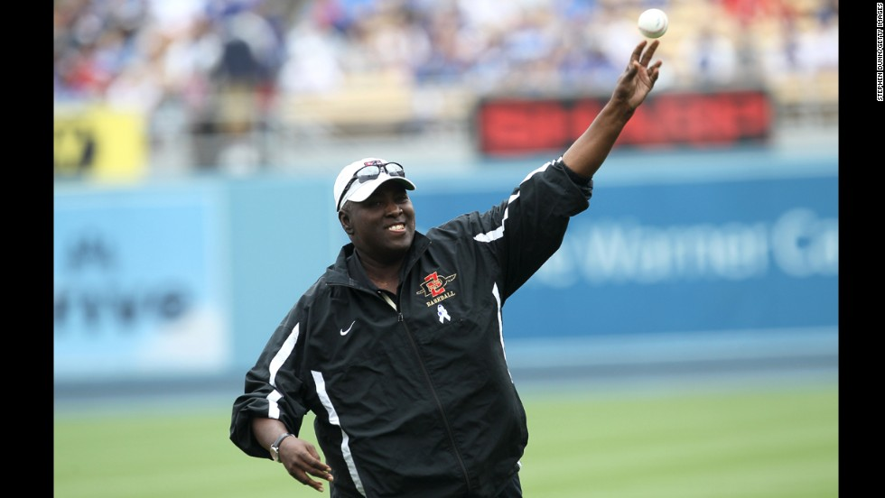 Gwynn throws out the first pitch to his son, Tony Gwynn Jr., before a 2011 game between the Los Angeles Dodgers and the Houston Astros on Father's Day. Gwynn's son was playing for the Dodgers at the time.
