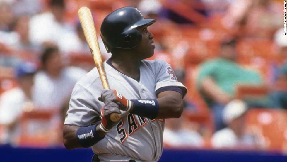 Gwynn watches the flight of a ball against the New York Mets in 1993. Gwynn finished his career with 3,141 career hits and a .338 batting average.