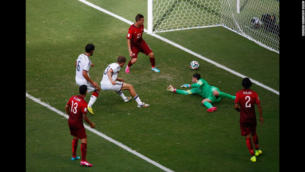 "Mueller completes his ""hat trick"" as he slots the ball past Portuguese goalkeeper Rui Patricio."