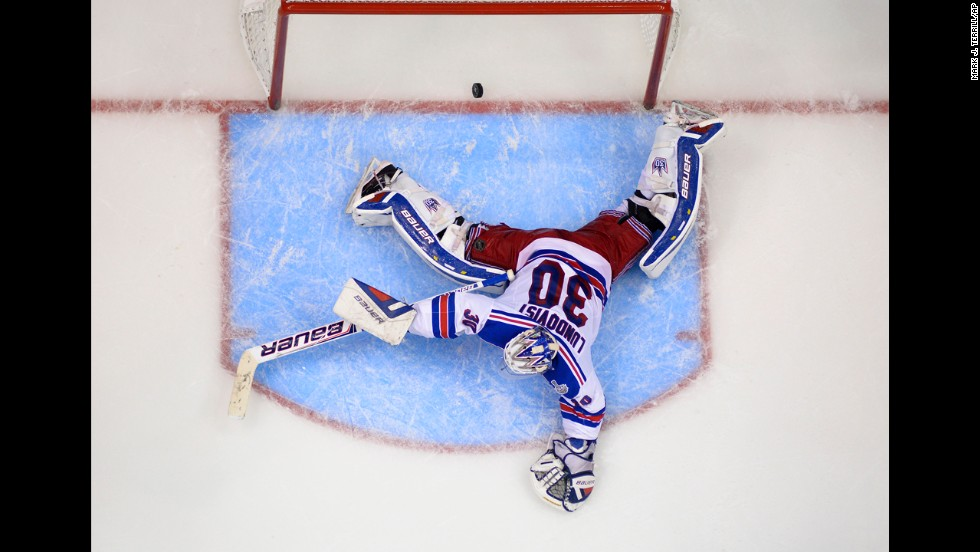 The puck flies past New York Rangers goalie Henrik Lundqvist to give the Los Angeles Kings a Stanley Cup-clinching victory on Friday, June 13. Alec Martinez scored the game-winning goal in double overtime to give the Kings their second Stanley Cup in three years.