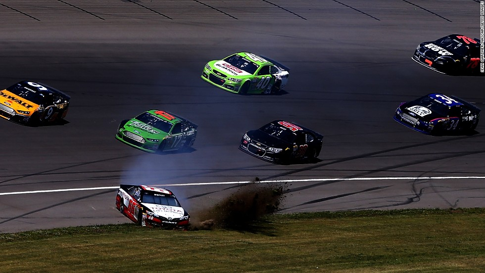 NASCAR driver Brett Moffitt spins into the grass during the Sprint Cup race at Michigan International Speedway on Sunday, June 15.