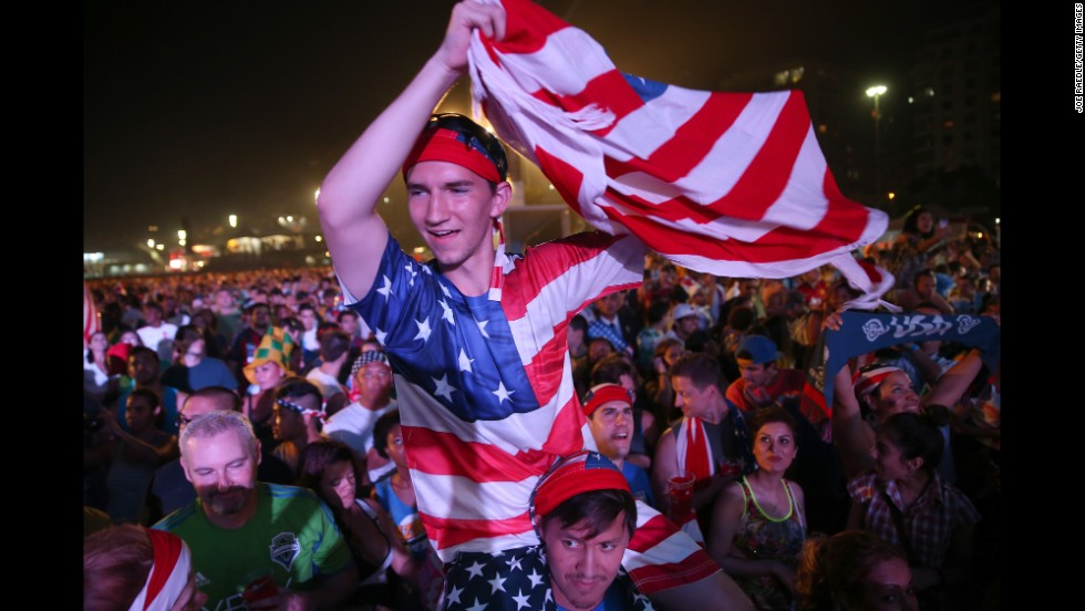American soccer fans gather on Copacabana beach in Rio de Janeiro before the game.