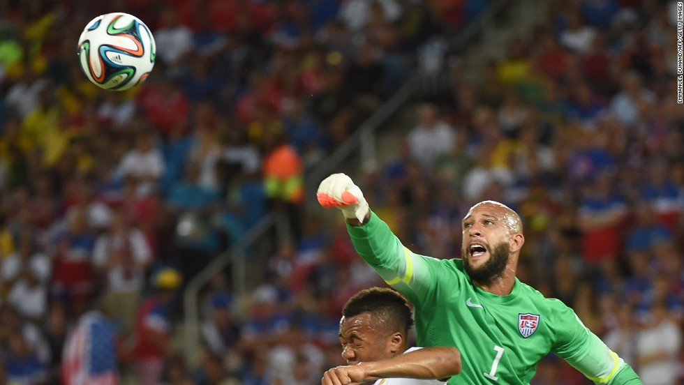 American goalkeeper Tim Howard punches the ball away.