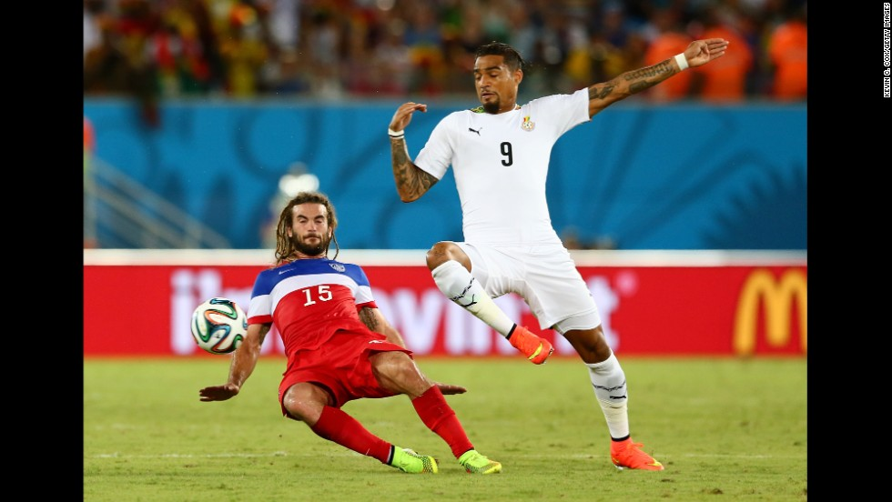 Kyle Beckerman of the United States tackles Kevin-Prince Boateng of Ghana.