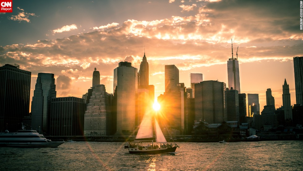 "The sun drifts below the New York City skyline on a late June evening. <a href=""http://ireport.cnn.com/docs/DOC-1140686"">Jeremy Aerts</a> found the perfect spot to drink in the view of the East River at Brooklyn Bridge Park."