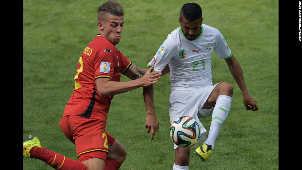 Belgian defender Toby Alderweireld, left, vies for the ball against Algeria's Riyad Mahrez.