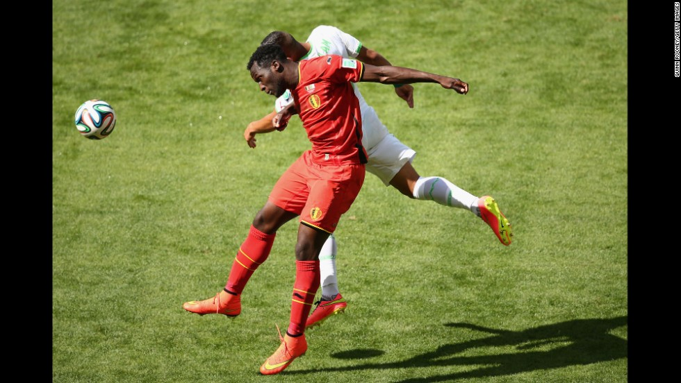 Lukaku and Faouzi Ghoulam of Algeria compete for a header.