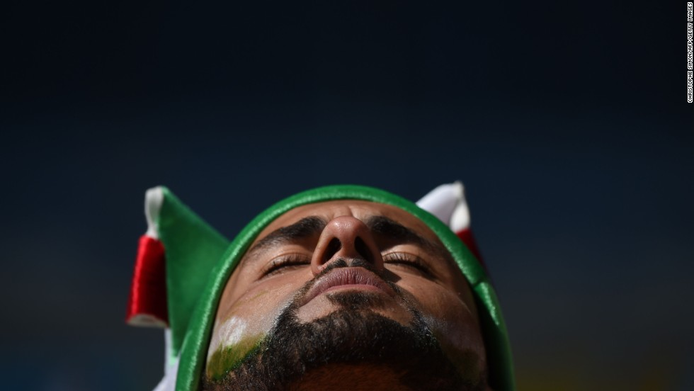 An Algeria fan is pictured prior to the match.