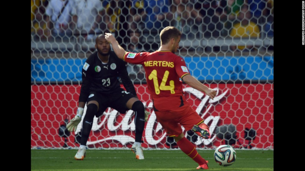 Belgium's Dries Mertens shoots what would turn out to be the winning goal during a World Cup match against Algeria on June 17 in Belo Horizonte, Brazil. Belgium won the match 2-1 after trailing 1-0 at halftime.