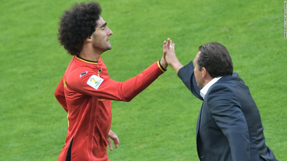 Belgian midfielder Marouane Fellaini high-fives his coach, Marc Wilmots, after scoring his team's first goal with a header.