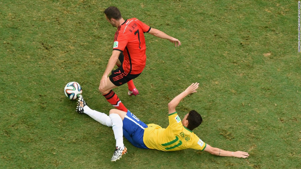 Oscar tackles Miguel Layun of Mexico.