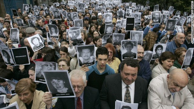 Members of the Jewish community make a minute's silence in commemoration of the 12th anniversary of the terrorist bombing against the Israelite Mutual Association (AMIA) which killed 85 people and injured 300, in Buenos Aires, 18 July 2006