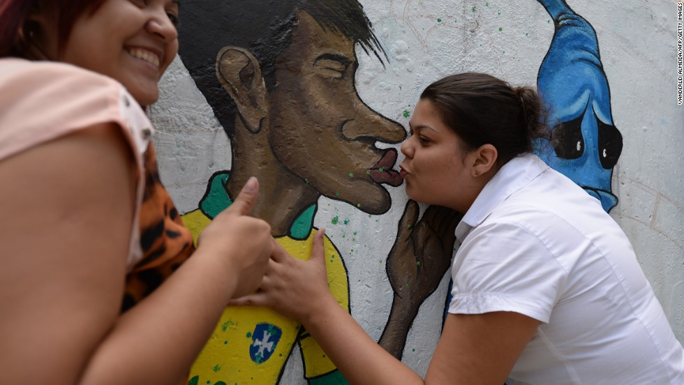 "Despite the growing excitement -- no doubt enhanced by Brazil's progression from the group stages to the round of 16 Monday -- Cranio underlines the emotional ambiguity still felt by many in his homeland about the event.<br /><br />""The World Cup is an event that is very beautiful and I like it a lot but Brazil is still a country that has many problems,"" he said. <br /><br />Here,Brazil's footballer Neymar kisses goodbye the ghost of the 'Maracanazo' (the defeat of Brazil by the winning Uruguayan team in the 1950 World Cup) in a Rio suburb."