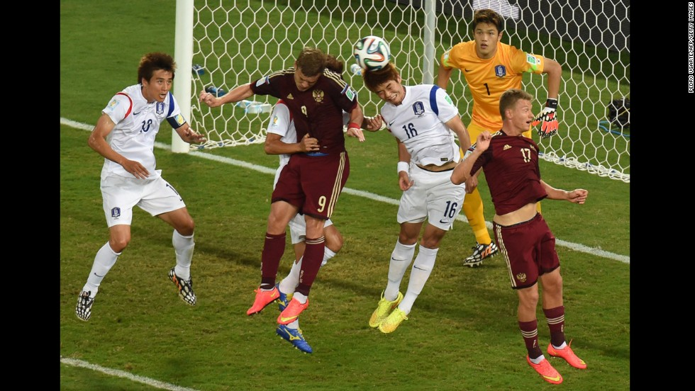 South Korean midfielder Ki Sung-Yueng, second from right, vies with Kokorin, second from left.