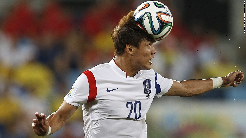 South Korean defender Hong Jeong-Ho heads the ball.