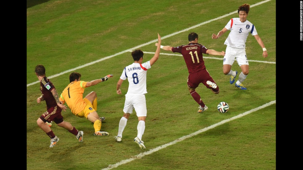 Russian forward Alexander Kerzhakov, second from right, scores the final goal of a 1-1 draw against South Korea on Tuesday, June 17, in Cuiaba, Brazil.