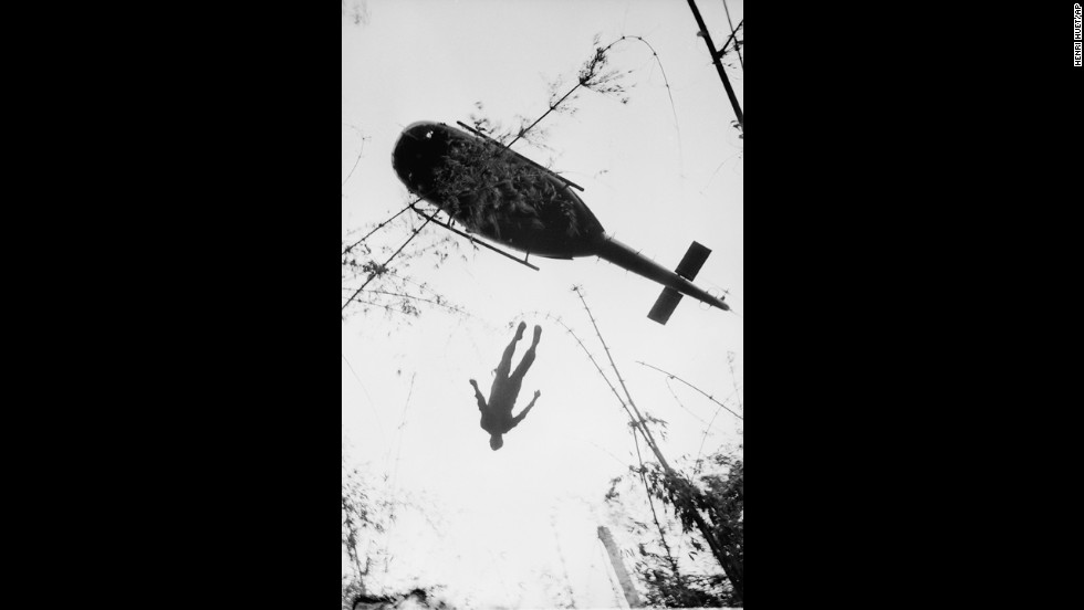 A helicopter raises the body of an American paratrooper killed in action in the jungle near the Cambodian border in 1966. Henri Huet, a French war photographer covering the war for the Associated Press, captured some of the most influential images of the war. Huet died along with LIFE photographer Larry Burrows and three other photographers when their helicopter was shot down over Laos in 1971.
