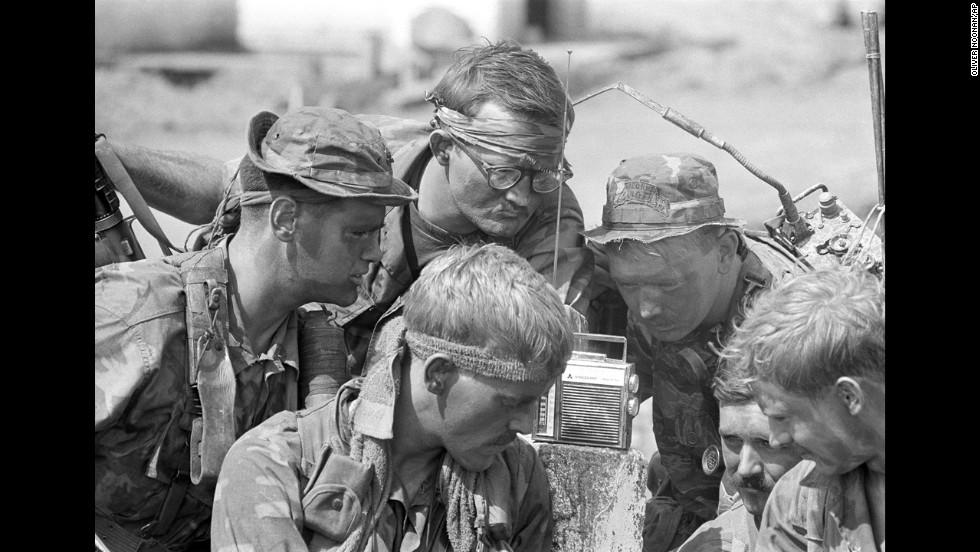 Oliver Noonan, a former photographer with the Boston Globe, captured this image of American soldiers listening to a radio broadcast in Vietnam in 1966. Noonan took leave from Boston to work in Vietnam for the Associated Press. He died when his helicopter was shot down near Da Nang in August 1969.