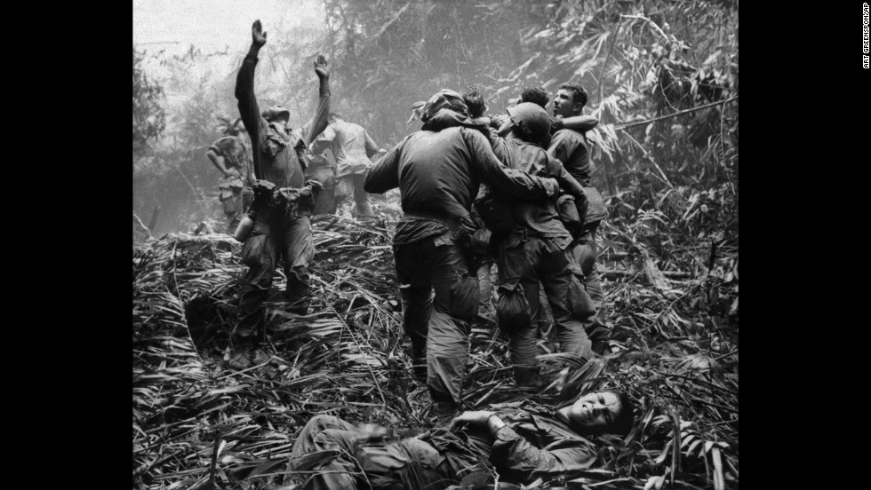 Associated Press photographer Art Greenspon captured this photo of  soldiers aiding wounded comrades. The first sergeant of A Company, 101st Airborne Division, guided a medevac helicopter through the jungle to retrieve casualties near Hue in April 1968.