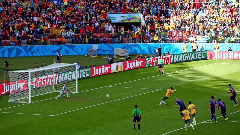 "A penalty kick from Australian captain Mile Jedinak gives the ""Socceroos"" a 2-1 lead over the Netherlands. The penalty was awarded after a handball was called against Dutch defender Daryl Janmaat."
