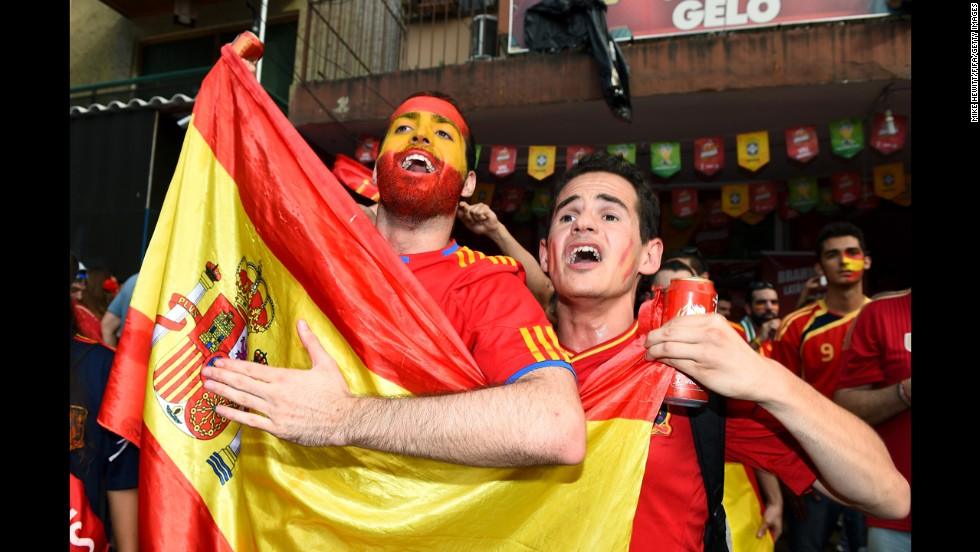 Spain fans cheer at the Maracana before the match.