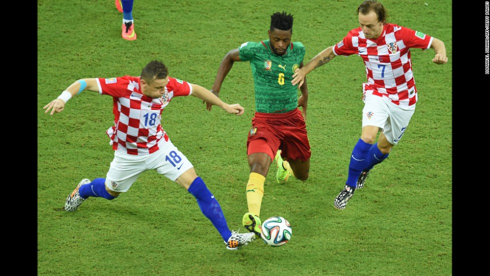 Ivica Olic of Croatia, left, and teammate Ivan Rakitic vie for the ball against Cameroon's Alexandre Song.