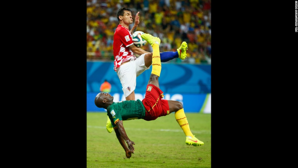 Pierre Webo of Cameroon attempts an overhead kick against Croatia's Dejan Lovren.