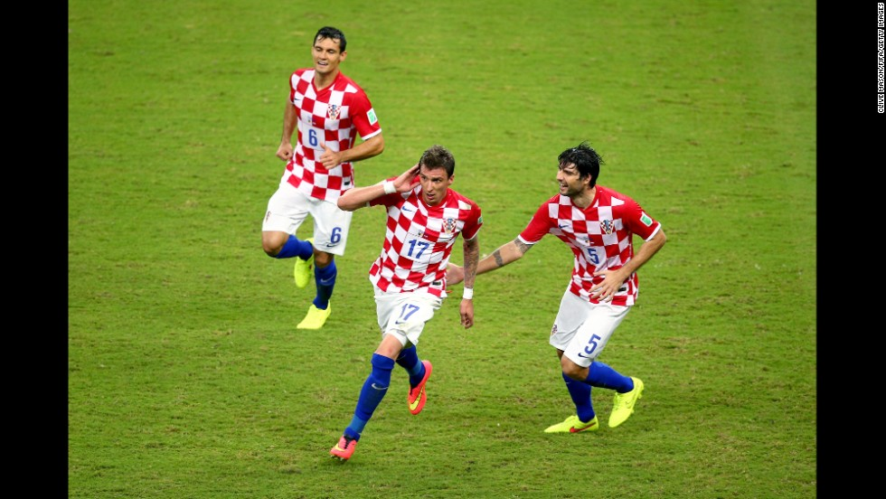 Mandzukic, center, celebrates scoring Croatia's third goal with his teammates Dejan Lovren, left, and Vedran Corluka.