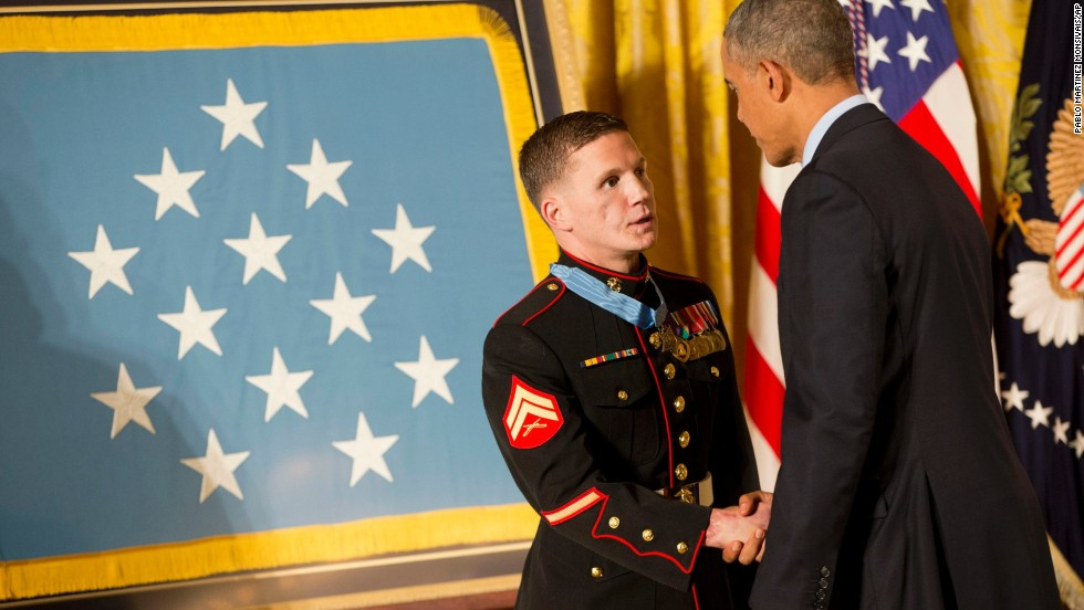 Retired Marine Cpl. Kyle Carpenter shakes hands with Obama as he receives the Medal of Honor on June 19. While serving in Afghanistan, Carpenter used his body to shield a fellow Marine from a grenade blast on November 21, 2010.