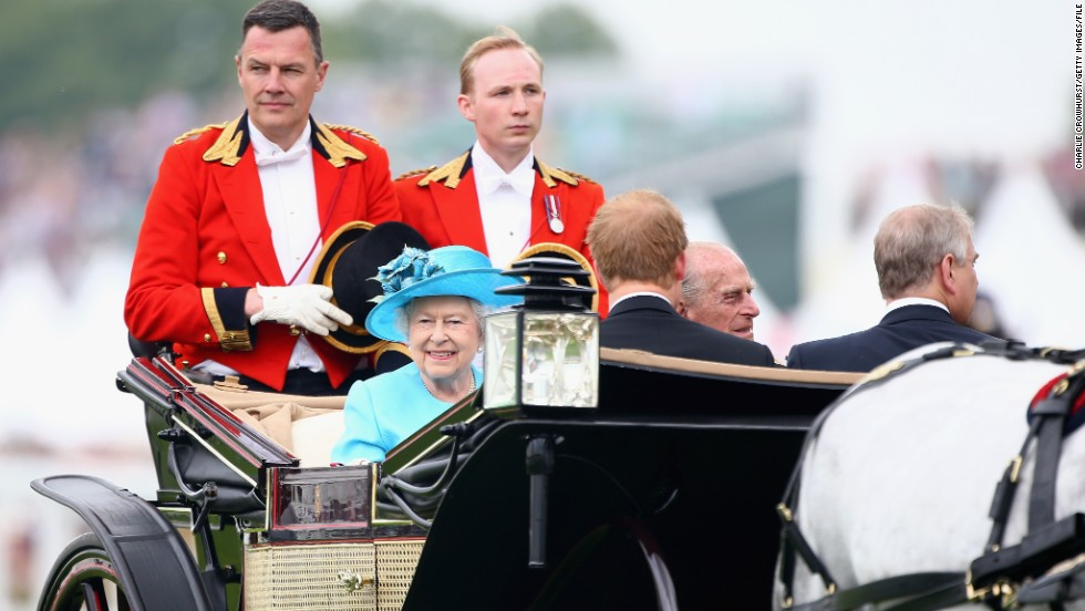 The prestigious five-day racing festival opens with Queen Elizabeth II parading around the track in an elegant horse-drawn carriage.