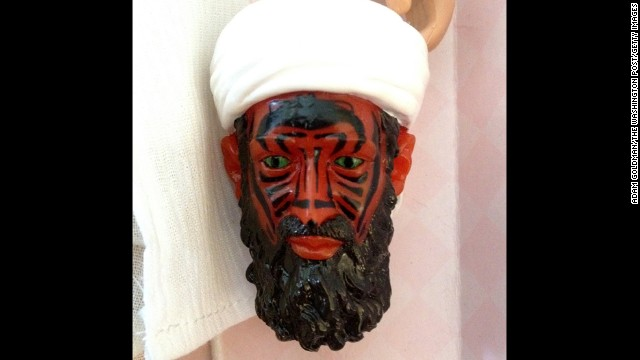The final version had the faces of the figures painted with a heat-dissolving material, designed to peel off and reveal a demon bin Laden.