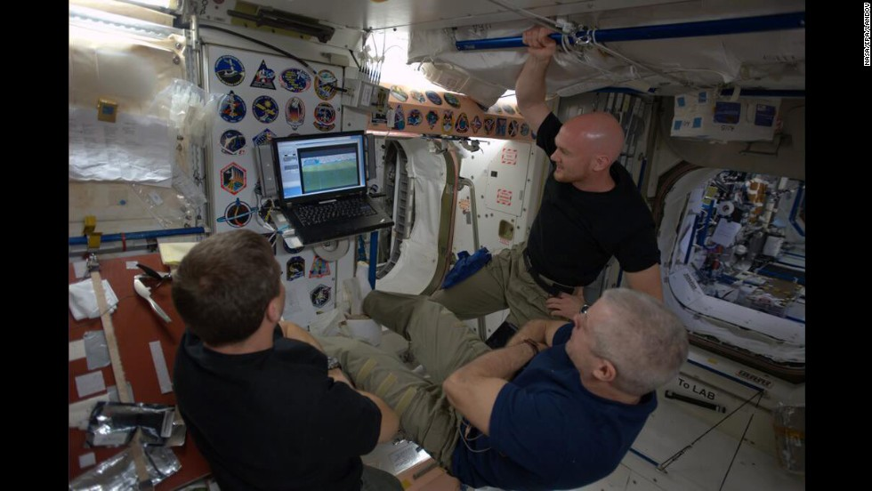 From left, astronauts Reid Wiseman, Steve Swanson and Alexander Gerst watch a World Cup soccer match on the International Space Station on Tuesday, June 17.