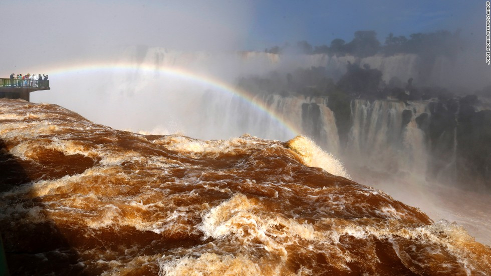 Tourists view Iguazu Falls from an observation platform at the Iguazu National Park in Brazil on Monday, June 16. Iguazu Falls forms a border between Argentina and Brazil, and it attracts more than 1 million visitors a year.