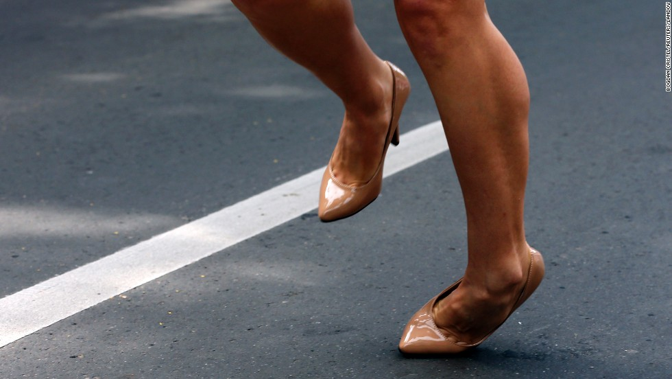 A participant stumbles during the Stiletto Run in Bucharest, Romania, on Saturday, June 14. The annual 50-meter (164-foot) race requires participants to wear high heels that are at least 7 centimeters tall.