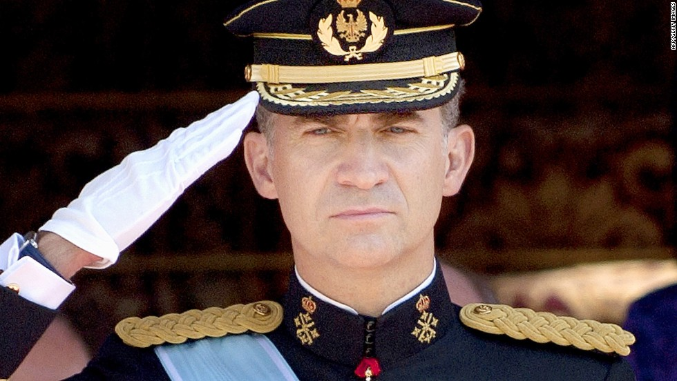 http://cdn.cnn.com/cnnnext/dam/assets/140620112436-spain-king-felipe-vi-salutes-horizontal-large-gallery.jpg